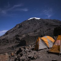 Two tents under the stars on a trek up Mt. Kilimanjaro.
