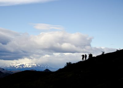 The silhouettes of hikers in the mountains of Patagonia.