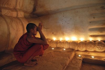 Buddhist monk praying inside the temple