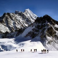 Climbers and sherpas making a glacier traverse on the way to Mera Peak.